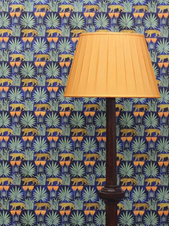 Voysey Wallpaper in Midnight with lamp